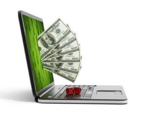 Online Casino Sic Bo dices on a laptop