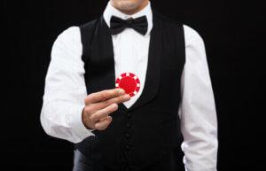 Live Dealer Casino Male Dealer holding casino chip